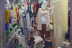 Mannequins and various clothes in a shop window Royalty Free Stock Photos