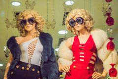 Mannequins wearing fashion sunglasses and in fashionable clothes royalty free stock photos