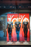 Mannequins wearing percentage discount t-shirts fall sale Royalty Free Stock Photography