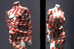 Mannequins winded with striped tape Stock Photos