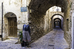 Mannequins with women dress on the narrow streets of Mesta Stock Images