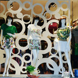 54d63ae6cc30 Mannequins in women s fashion shop window royalty free stock photography