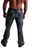 Mannesrückseite in den Jeans trennte Weiß Lizenzfreie Stockfotografie