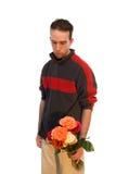 Mannetje dat een Vaas van Bloemen houdt stock fotografie