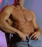 Mannetje in jeans Stock Afbeeldingen