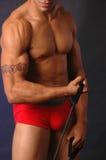 Mannetje met oefeningsriem Stock Foto