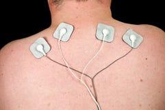 Mannetje met scherpe halspijn, elektroden aan tientalleneenheid Royalty-vrije Stock Foto