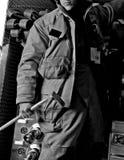 Mannetje op brandvrachtwagen Royalty-vrije Stock Afbeelding