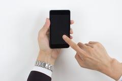 Mannhandnoten-Handy Lizenzfreie Stockfotografie