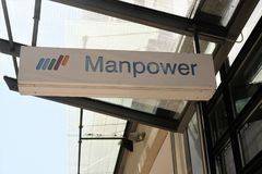 Manpower signboard. Mannheim, Germany - August 23, 2017: Manpower signage outside a building. ManpowerGroup is a Fortune 500 American multinational corporation Stock Photos