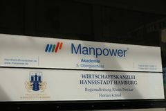 Manpower signboard. Mannheim, Germany - August 23, 2017: Manpower signage outside a building. ManpowerGroup is a Fortune 500 American multinational corporation Stock Images