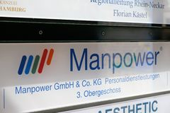 Manpower signboard. Mannheim, Germany - August 23, 2017: Manpower signage outside a building. ManpowerGroup is a Fortune 500 American multinational corporation Stock Image