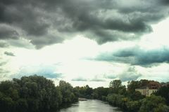 Mannheim Seckenheim Neckar river nature cloud sky rain stock photography