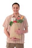 Mannholding-Einkaufstasche Lizenzfreies Stockfoto