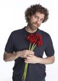 Mannholdingblumen Stockfotografie