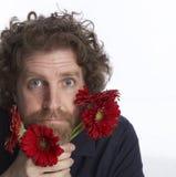 Mannholdingblumen Stockfoto