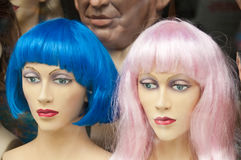 Mannikin heads with colorful wigs in wig store Stock Images