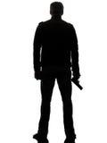 Mannmörderpolizist, der gehendes Schattenbild des Gewehrs hält Stockfotos