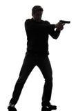 Mannmörderpolizist, der stehendes Schattenbild des Gewehrs zielt Stockbild
