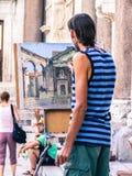 Mannmalerei auf der Straße Lizenzfreie Stockfotografie