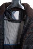 Mannmantel lokalisiert auf dem weißen Hintergrund Stockfotografie