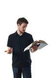 Mannmesswert von einem großen Buch Lizenzfreies Stockfoto