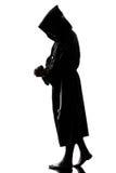 Mannmönchpriester-Schattenbildbeten Lizenzfreie Stockfotografie