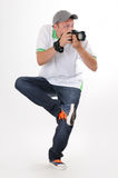 Mannphotograph mit Kamera in der lustigen Haltung Stockfotografie