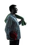Mannpyjamamorgenpflegenschattenbilder Stockbilder