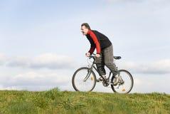 Mannradfahren Stockfoto