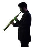 Mannsaxophonist, der Saxophonspielerschattenbild spielt Lizenzfreies Stockbild