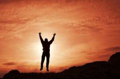 Mannschattenbild auf Sonnenuntergang Lizenzfreie Stockfotos