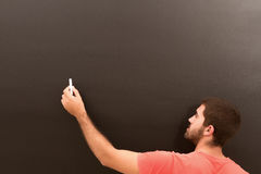 Mannschreiben auf dem Brett Stockfoto