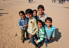 Manny boys standing one by one. JAISALMER, INDIA - MAR 2: Unidentified happy boys standing one by one in the crowd of people during the famous indian Desert Stock Photography