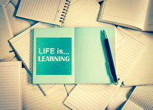 Manny empty notebook paper and note pad background with one blue Royalty Free Stock Photos