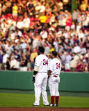 Manny Ramirez and David Ortiz stand for the National Anthem. Royalty Free Stock Images