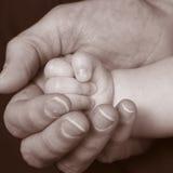 Mano 3 del bebé Fotos de archivo