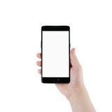 Mano adolescente femenina que sostiene smartphone con la pantalla en blanco aislado Imágenes de archivo libres de regalías