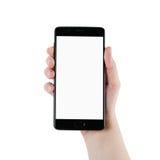 Mano adolescente femenina que sostiene smartphone con la pantalla en blanco aislado Imagen de archivo