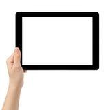 Mano adolescente femenina usando la PC de la tableta con la pantalla blanca Fotografía de archivo