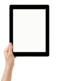 Mano adolescente femenina usando la PC de la tableta con la pantalla blanca Imagenes de archivo