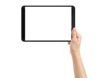 Mano adolescente femenina usando la PC de la tableta con la pantalla blanca Imagen de archivo