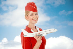 Mano affascinante di Holding Airplane In dell'hostess Fotografia Stock Libera da Diritti