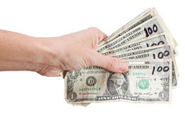 Mano aislada con los dólares falsos Foto de archivo libre de regalías
