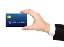 Mano aislada de un hombre de negocios que sostiene una tarjeta de crédito Fotografía de archivo libre de regalías