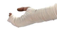 Mano blanca de lesión del vendaje de la medicina en el fondo blanco Foto de archivo