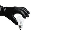 Mano che afferra lampadina Fotografia Stock Libera da Diritti