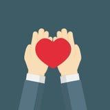 Mano che dà il heartlove rosso Immagine Stock