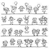 Mano che disegna i bambini felici Fotografie Stock