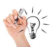 Mano che disegna lampadina Fotografie Stock Libere da Diritti